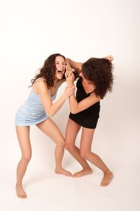 Bigstockphoto_Two_Young_Fighting_Women_556269