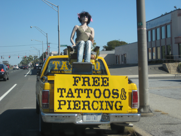 the road I came across this truck parked in front of a tattoo parlor.